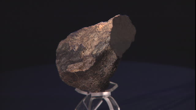 a sample of a meteorite rotates against a black background. - payson stock videos & royalty-free footage