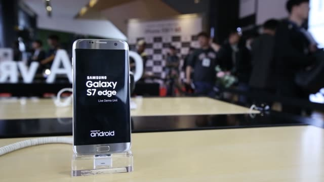a samsung electronics co galaxy s7 edge smartphone stands on display at kt corp's olleh square flagship store in seoul south korea on friday oct 21 a... - at the edge of stock videos and b-roll footage