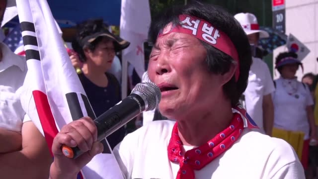 samsung heir lee jae yong's supporters burst into tears as lee is sentenced to five years in prison for bribery and other offences in connection with... - heir stock videos and b-roll footage