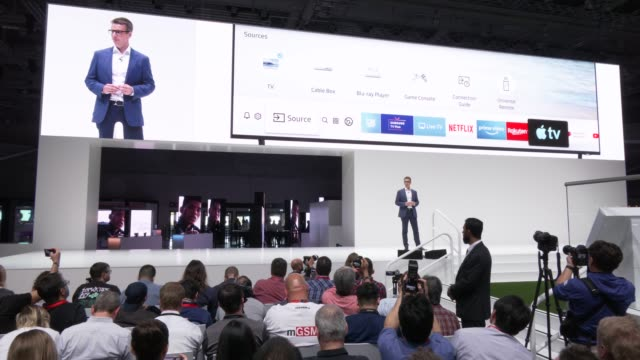 samsung spokesman announces at cooperation with apple for apple tv at the samsung press conference at the 2019 ifa home electronics and appliances... - press conference点の映像素材/bロール