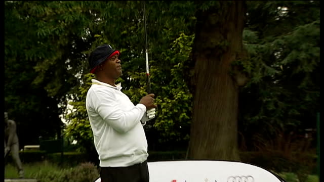 samuel l jackson hosts charity golf tournament england surrey wentworth golf course ext samuel l jackson driving a shot others watching oliver phelps... - oliver phelps stock videos & royalty-free footage