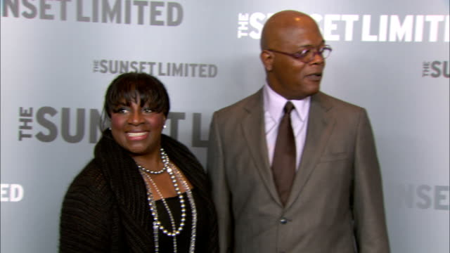 Samuel L Jackson wife LaTanya Richardson posing for paparazzi on the red carpet at the Time Warner Screening Room