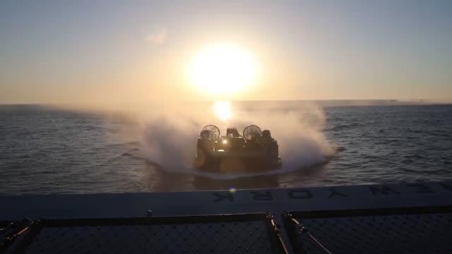 san antonioclass amphibious transport dock ship uss new york conducts well deck operations in the mediterranean sea - amphibienfahrzeug stock-videos und b-roll-filmmaterial