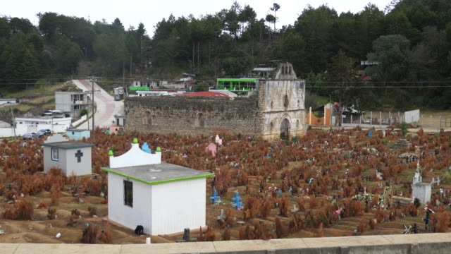 san cristóbal de las casas,the san juan chamula cemetery, with the day of the dead decorations and the old burnt church. - capitali internazionali video stock e b–roll
