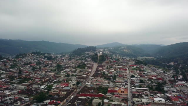 stockvideo's en b-roll-footage met san cristobal de las casa aerial video back from church of guadalupe virgin - city of neighbors: give once for all film title