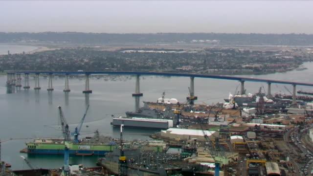 kswb san diego ca us aerial view of coronado bridge over san diego bay on wednesday april 1 2020 - industrial district stock videos & royalty-free footage