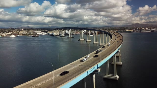 vídeos y material grabado en eventos de stock de san diego, ca, u.s. - aerial view of traffic on coronado bridge and sailboats on monday, january 6, 2020. - anclado