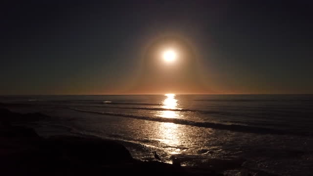san diego, ca, u.s. - drone aerial view of sunset over sea, with seagull perching on coastline cliff, on wednesday, february 10, 2021 - horizon over water stock videos & royalty-free footage