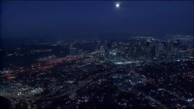kswb san diego ca us full moon over cityscape on thursday december 12 2019 - san diego stock videos & royalty-free footage