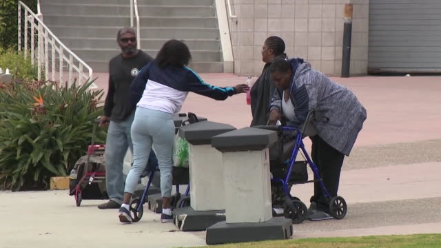 kswb san diego ca us homeless people gathering in convention center's temporary homeless shelter in san diego on tuesday april 7 2020 - tramp stock videos & royalty-free footage