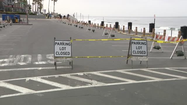 kswb san diego ca us information signs at closed carlsbad beaches during covid19 pandemic on friday april 3 2020 - カールズバッド点の映像素材/bロール