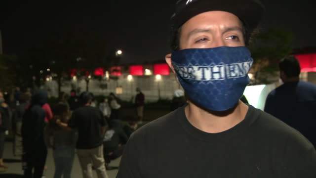 san diego, ca, u.s. - interview with organizer of memorial vigil held for detainee confirmed to be 1st covid-19 related death of otay mesa detention... - アメリカ移民税関捜査局点の映像素材/bロール