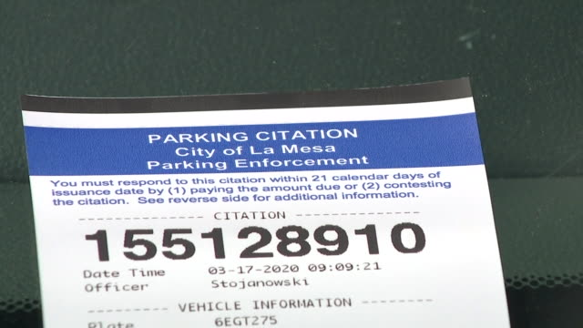 san diego, ca, u.s. - no parking sign and parking citation after la mesa suspends issuing parking tickets on tuesday, march 17, 2020. - no parking sign stock videos & royalty-free footage
