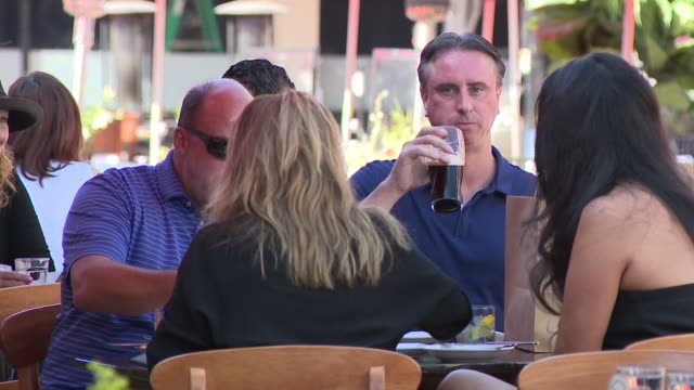 san diego, ca, u.s. - people dining outside, masked staff sanitizing tables as businesses reopen amid coronavirus pandemic, on monday, august 31,... - dining stock videos & royalty-free footage