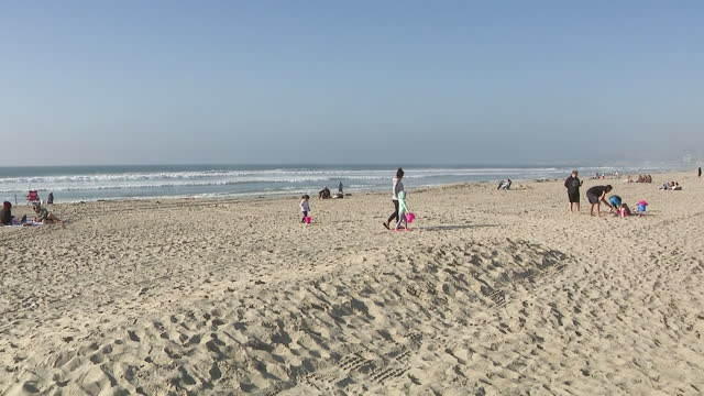 san diego, ca, u.s. - people spending time on beach amid coronavirus pandemic on wednesday, january 13, 2021. - horizon over water stock videos & royalty-free footage