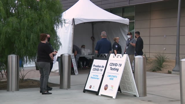 san diego, ca, u.s. - signage and people waiting in line for test. a new county testing site for the coronavirus opened at the u.s. - mexico border... - san diego stock videos & royalty-free footage