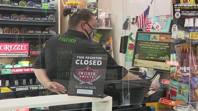 san diego, ca, u.s. - store cashier printing out lottery tickets as mega millions, powerball jackpot soars, on wednesday, january 13, 2021. - printing out stock videos & royalty-free footage