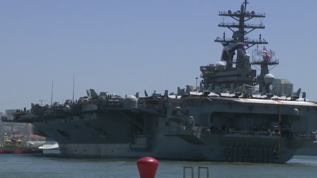 san diego, ca, u.s. - tugboats pushing uss nimitz as it's leaving for deployment on monday, june 8, 2020. - aircraft carrier stock videos & royalty-free footage