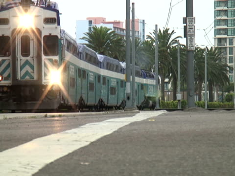 san diego: double decker commuter train crosses - level crossing stock videos & royalty-free footage