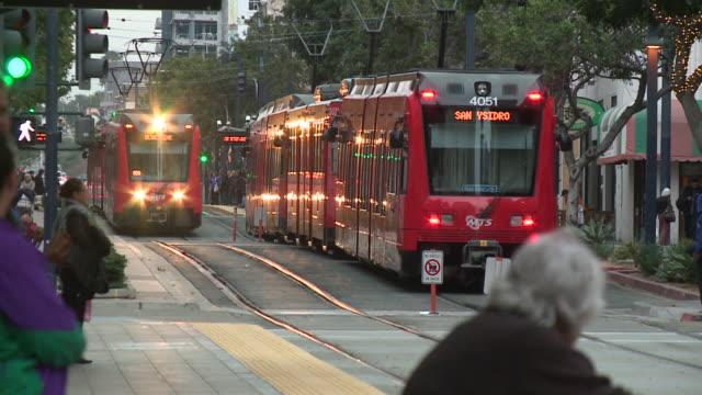 kswb san diego metropolitan transit system - trolleybus stock-videos und b-roll-filmmaterial