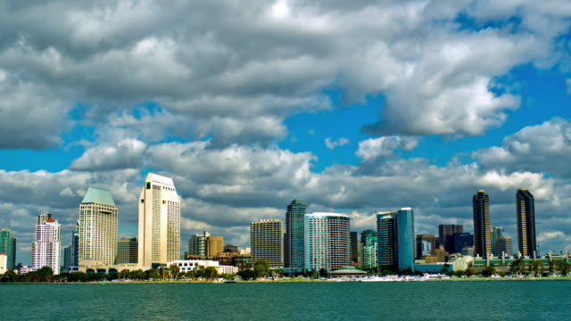 vidéos et rushes de ws t/l san diego waterfront high-rise buildings near embarcadero marina  and convention center with dramatic rain clouds moving across blue sky  / san diego, california, usa - san diego