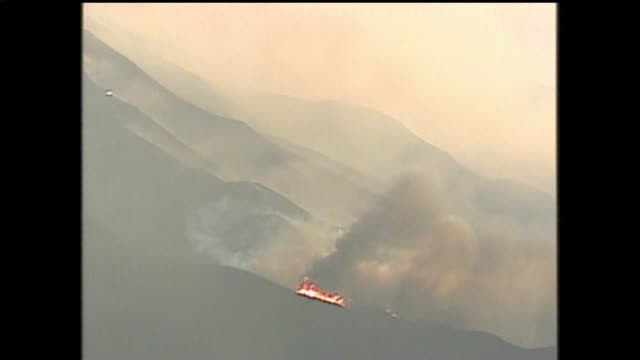 stockvideo's en b-roll-footage met san diego's 427-square-mile cedar fire in oct. 2003, which destroyed more than 2,800 structures and killed 14, remains the largest wildfire in state... - 2003