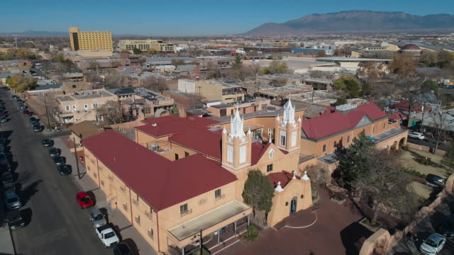 san felipe de neri church - the oldest catholic church in albuquerque, new mexico, usa, in the sunny winter day. aerial drone video with the forward camera motion. - new mexico stock videos & royalty-free footage