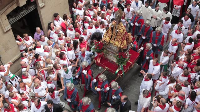 san fermin is taken out from his home church for a parade around the old town of pamplona spain during the san fermin festivities on july 7 2012... - comunidad foral de navarra stock videos and b-roll footage