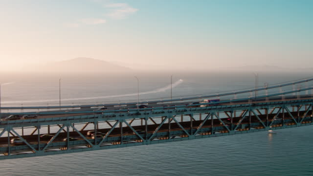 san francisco aerial bay bridge cars - san francisco oakland bay bridge stock videos and b-roll footage