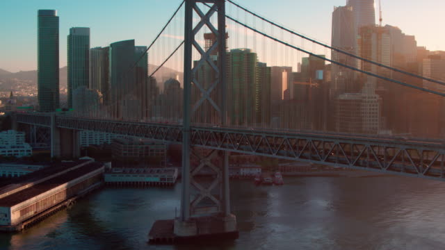 aerial bay bridge in san francisco - san francisco california stock-videos und b-roll-filmmaterial