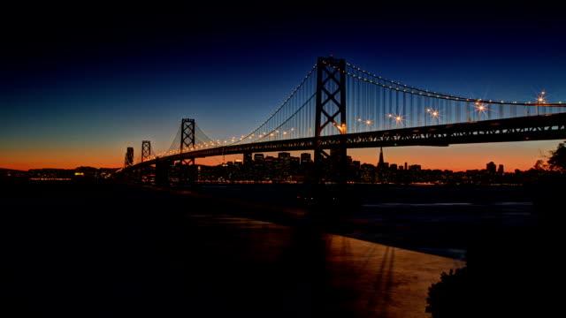 san francisco bay bridge sunset view - san francisco oakland bay bridge stock videos & royalty-free footage