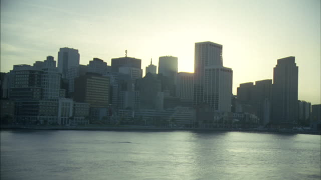 San Francisco bay during golden hour running along coastline of the financial district.