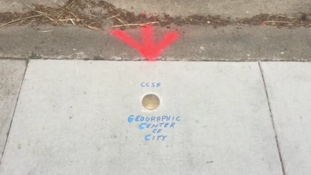 san francisco's department of public works marked the geological center of the city with a brass marker on the 700 block of corbett avenue near... - physische geographie stock-videos und b-roll-filmmaterial