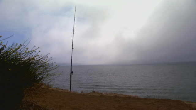 san francisco, californiafishing pole on ocean cliff - fishing rod stock videos and b-roll footage