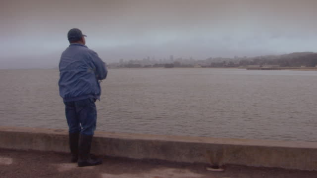 san francisco, californiaman fishing off pier - one mature man only stock videos & royalty-free footage