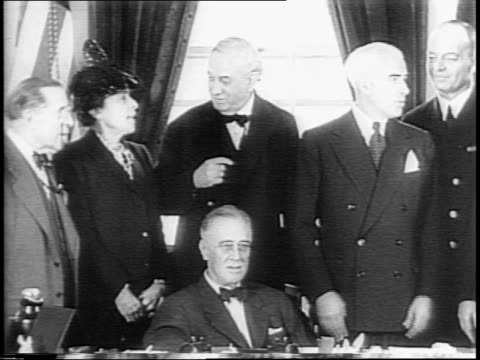san francisco cityscape / golden gate bridge / president franklin d roosevelt at desk with us delegation stood behind / in geneva, woodrow wilson... - 1945 stock-videos und b-roll-filmmaterial