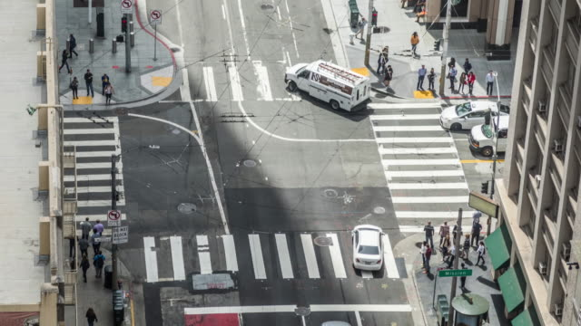 san francisco crosswalk pedestrians and cars time lapse - crosswalk sign stock videos & royalty-free footage