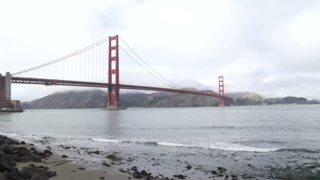 san francisco golden gate bridge in thick fog in afternoon - wide stock videos & royalty-free footage