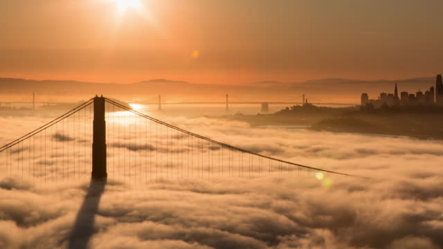 san francisco golden gate bridge sunrise in low fog morning light - golden gate bridge stock videos & royalty-free footage