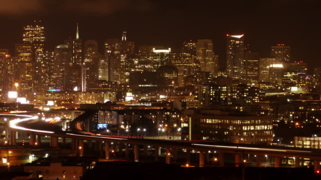 san francisco night skyline with highway in the foreground. zoom in. view from potrero hill. - spoonfilm stock-videos und b-roll-filmmaterial