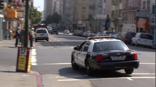 a san francisco police vehicle turns left. - san francisco california stock videos & royalty-free footage