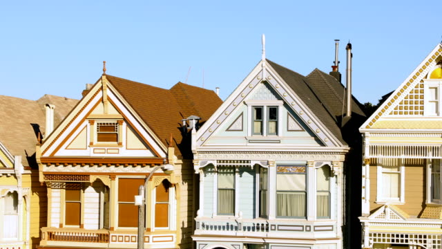 san francisco row of painted victorian houses 4k video left pan - san francisco california stock videos and b-roll footage