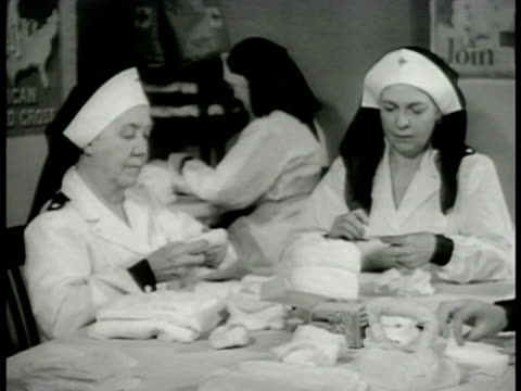 San Francisco street steep buildings DRAMATIZATION Two Red Cross nurses packing bandages 'We've got buckets of water all ready for incendiary bombs'...