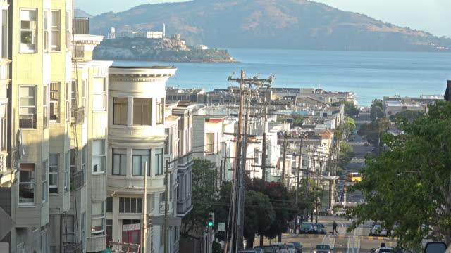 san francisco sunrise city architecture with a view towards alcatraz - fisherman's wharf san francisco stock videos & royalty-free footage