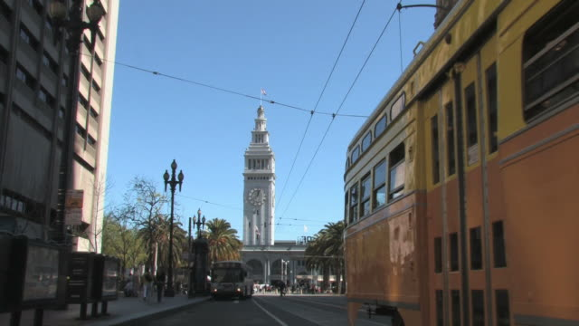 san francisco tram and ferry building clock tower - san francisco ferry building stock videos & royalty-free footage