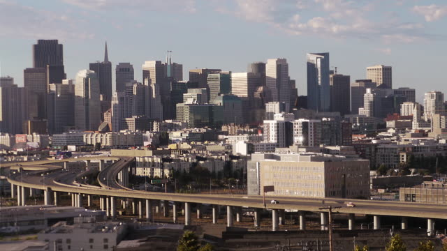 san francisco urban skyline with highway in the foreground. view from potrero hill. - spoonfilm stock-videos und b-roll-filmmaterial