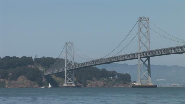 san franciscooakland bay bridge over san francisco bay in san francisco united states - backwater stock videos & royalty-free footage