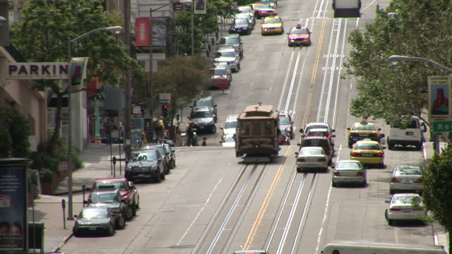 san franciscoview of a city street in san francisco united states - trolleybus stock-videos und b-roll-filmmaterial
