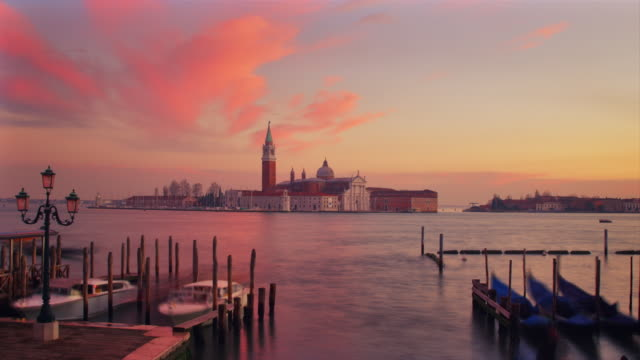 ws - san giorgio maggiore church, gondolas passing in the foreground - venice italy stock videos and b-roll footage