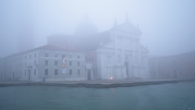 san giorgio maggiore church on foggy day seen from boat - lagoon stock videos & royalty-free footage